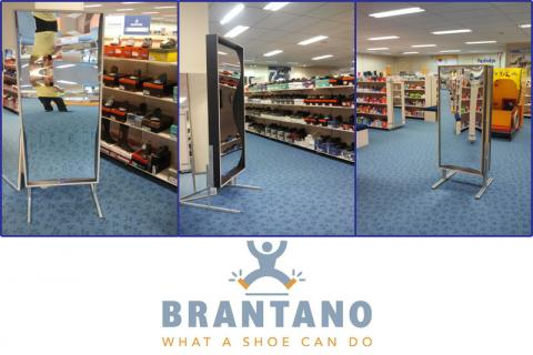 Instore action in shoe store. Laughing puts the customer in a good (buying) mood!